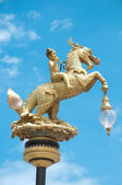 Boy rides horse in Thai Style as street lamp — Stock Photo
