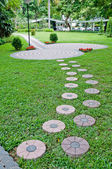 Beautiful block walkway in the green garden — Stock Photo