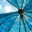 Blue umbrella from bottom view — Stock Photo