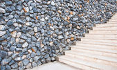Marble stairs with wall rock — Stock Photo