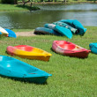 Colorful canoe on grass — 图库照片 #33209513