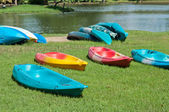 The colorful canoe on the grass — Stock Photo