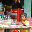 Indian boy selects snack in the grocery — Stok fotoğraf