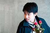 A teenager vampire with red roses — Stock Photo