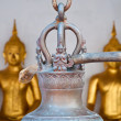 The wooden stick hange on the thai style bell in the temple in T — Stock Photo