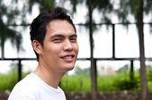 An asian man smiling at camara — Stock Photo
