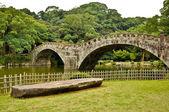 Stone bridge in Japanese garden at Isahaya, Japan — Stock Photo