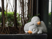 The couple of sleeping duck made from cement for decoration — Photo