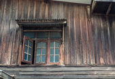 The window of the old wooden house — Stock Photo