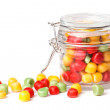 Colorful candies in glass jar.  — Stock Photo