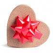 Heart shaped gift box with red bow. — Stock Photo