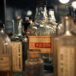 Stock Photo: Close-up of poison in antique bottle