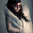 Portrait of young woman with sugar skull make-up . Dramatic lighting. — 图库照片 #29401715