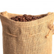 Coffee bag made from burlap fully filled with coffee beans — Stock Photo #29401841