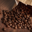 Coffee beans in a paper bag — Stockfoto