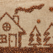 House and Christmas tree made from coffee beans. — Stock Photo #29402927