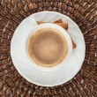 White cup of coffee with cinnamon sticks — Stock Photo