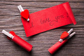 Red piece of paper with I love you title on wooden board. — Stock Photo