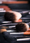 Professional make-up brushes with eye shadows palette — Stock Photo