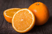 Close-up of orange fruit on wooden table. — Stock Photo