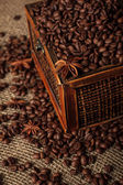 Old wooden chest with coffee beans and anise stars — Stock Photo