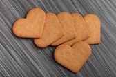 Cookies in shape of a heart on wooden table. — Stock Photo