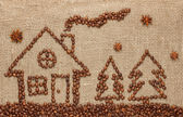 House and Christmas tree made from coffee beans. — Stock Photo