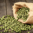 Green coffee beans in bag — Stock Photo #43713459