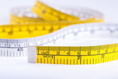 Yellow measuring tape — Stok fotoğraf