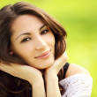 Image of young beautiful woman in summer park smiling — Stock Photo #29274205