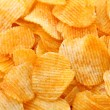 Corrugated potato chips background — Stock Photo