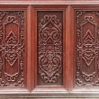 Ancient art pattern on the wooden door in Thailand temple — Stock Photo