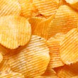 Stock Photo: Potato chips background