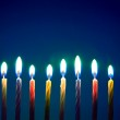 Image of eight birthday candles over blue background — Stock Photo