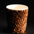 Image of paper cup covered with coffee beans — Stock Photo