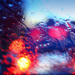 Stock Photo: Raindrops on car windscreen