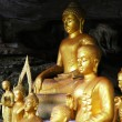 Stock Photo: Sculptures of Buddhin cave