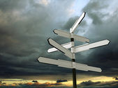 Image of blank signpost over dramatic sky — Stock Photo