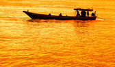 Image of long tailed boat at sunset in Thailand — Stock Photo
