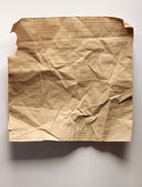 Image of old crumpled paper on wall — Stock Photo
