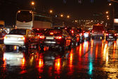 Wet night road with cars at stopline. Autumn, rain, reflections. — Stock Photo
