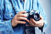 Image of photohrapher with film camera — Stock Photo