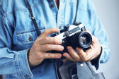 Image of photohrapher with old-style camera — Stock Photo