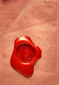 Image of red wax stamp over grunge background — Stock Photo