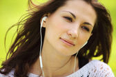 Image of young beautiful woman in summer park enjoy music — Stock Photo