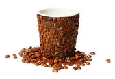 Paper cup covered with coffee beans — Stock Photo