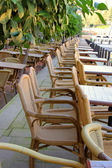 Street cafe with wicker chairs — Stock Photo