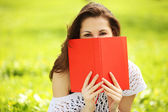 Image of young beautiful woman in summer park with a book — Stock Photo
