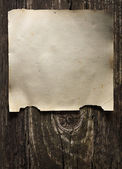 Image of old stained paper on wooden background — Stock Photo