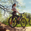 Woman with bicycle in a park — Stock Photo